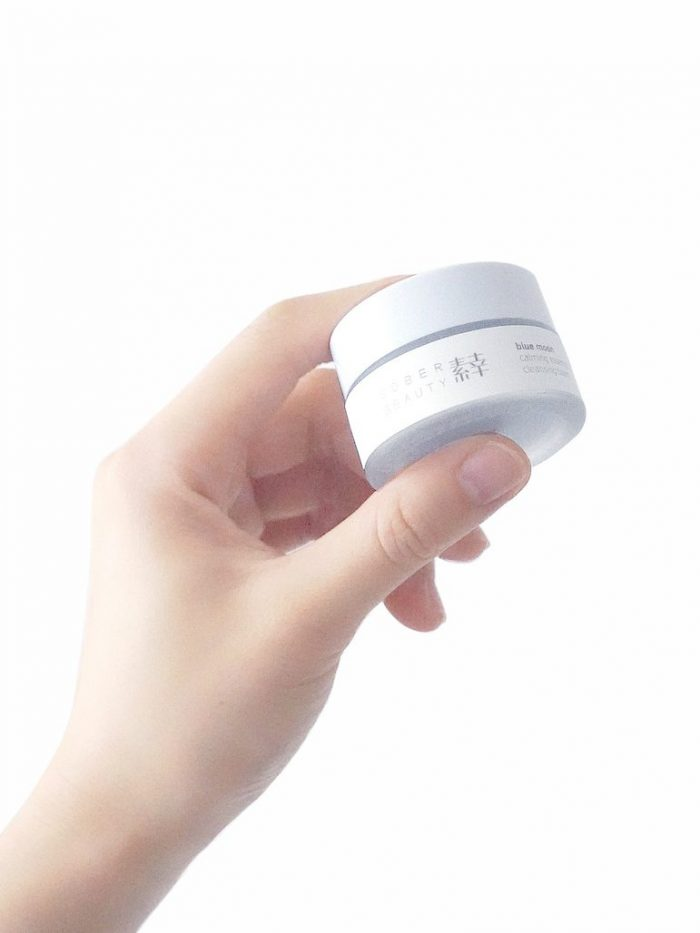 Travel size (15g) Sober Beauty cleansing balm held in hand
